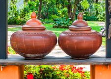 Closeup to Couple of Brown Baked Clay Flagon in Ancient Tradition Northern Thai Style royalty free stock image