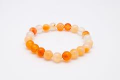 Closeup to Cute Orange Amulet Made of Stones Bracelet, Isolated Stock Images