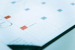 Closeup to December 25 on calendar Schedule Royalty Free Stock Images