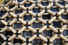 Closeup to dirty tire chain of a loader Royalty Free Stock Photography