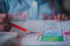 Closeup to Elementary school student are coloring. royalty free stock photography