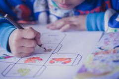 Closeup to Elementary school student are coloring. stock image