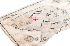 Closeup to fake treasure map with red cross of Pirates Chest. Abstract island with pirates treasure chest Royalty Free Stock Photo