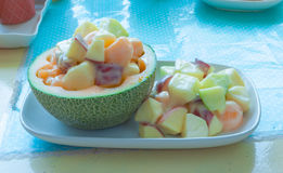 Closeup to Fresh Fruit Salad in Melon Peel Royalty Free Stock Photography