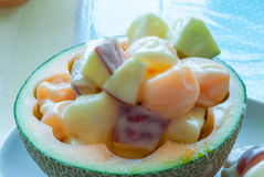 Closeup to Fresh Fruit Salad in Melon Peel Stock Images