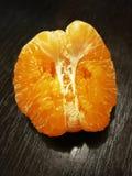 Peeled mandarin orange on black Royalty Free Stock Images