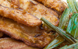 Closeup to Fried Bananas and Pandan Leaves Background Royalty Free Stock Image