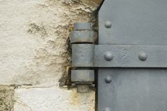 Hinge of an old iron door Stock Photo