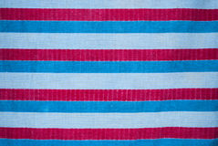 Closeup to Horizontal White Blue and Red Striped Fabric Background.  Stock Image