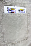 Closeup to jeans pocket with game cards Royalty Free Stock Images