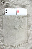 Closeup to jeans pocket with game cards Royalty Free Stock Photo
