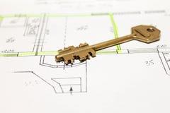 Closeup to key on house plan Stock Photos
