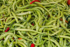 Closeup to a Large Amount of Green Chilli Peppers Royalty Free Stock Photo