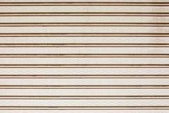 Closeup to Light Brown Metal Shutter Door, Background/ Texture Stock Image