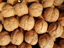 Walnuts. Closeup to lots of Walnut kernels and whole walnuts .Full background Royalty Free Stock Photography