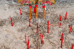 Closeup to Many Red Incense Sticks after Worship Ceremony Stock Photos