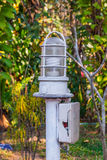 Closeup to Outdoor Broken Junction Box with White Lamp in Garden Stock Images