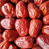 Big Red Date - Jujube Fruit. Closeup to a Red Date - Jujube Fruit - /Fructus Jujubae on black background.Ziziphus jujuba,commonly called jujube, red date royalty free stock photography