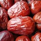 Big Red Date - Jujube Fruit. Closeup to a Red Date - Jujube Fruit - /Fructus Jujubae on black background.Ziziphus jujuba,commonly called jujube, red date royalty free stock image