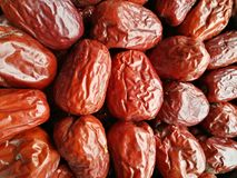 Big Red Date - Jujube Fruit. Closeup to a Red Date - Jujube Fruit - /Fructus Jujubae on black background.Ziziphus jujuba,commonly called jujube, red date royalty free stock photo