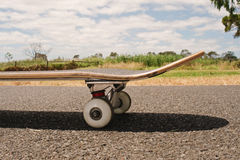 Closeup to skateboard of asphalt Royalty Free Stock Photography