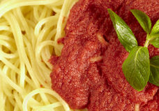 Closeup to a spaghetti with tomato sauce. Spagetti with tomato souce shot in studio. Top view, like the italy flag Stock Photo