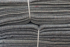 Closeup to Stack of Gray Blankets Tied With White Plastic Rope Background Stock Photos