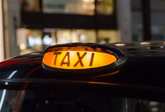 Closeup to a Taxi Sign Royalty Free Stock Photography
