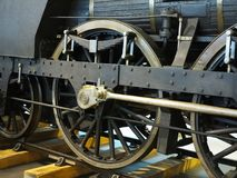 Closeup to wheels of old vintage steam engine locomotive train Stock Images