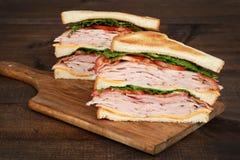Closeup toasted chicken club sandwich Stock Photos