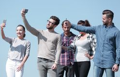 Closeup.today`s young people are taking selfies. stock photos