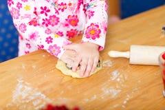 Closeup of toddler girl baking Stock Photo