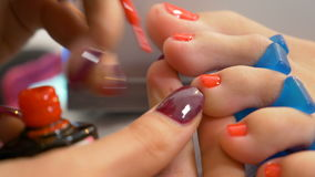 Closeup with toe nails of woman getting semi permanent pedicure. Close up with toe nails of woman getting semi permanent pedicure stock footage
