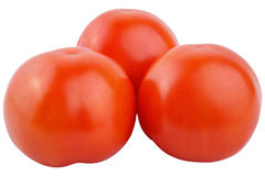 Closeup tomatoes isolated on white background. Whole tomatoes isolated on white background as package design element royalty free stock photography