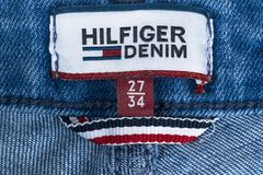 Closeup of Tommy Hilfiger label on blue jeans. Tommy Hilfiger is lifestyle brand. Hilfiger Denim. Tommy Hilfiger blue jeans detail Royalty Free Stock Photography