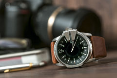 Closeup toned shot of male watches lying on table against photog. Raphy retro set Stock Photos
