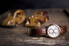 Closeup toned shot of male watches lying on table against  retro. Set Stock Photos