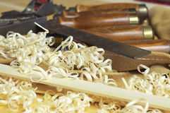 Closeup of tools. Closeup of fine woodworking tools with shavings Royalty Free Stock Photo