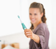 Closeup on toothbrush in hand of young woman Royalty Free Stock Photo