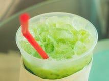Closeup on top cup of icy milk green tea Royalty Free Stock Photos