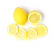 Closeup top view fresh lemon fruit and slice on white background Stock Images