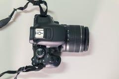 Closeup top view of modern black DSLR camera on white background.  Stock Photo