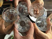 Closeup Top View of people holding glasses of water stock photo