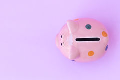 Closeup top view pink ceramic piggy bank on pink background Royalty Free Stock Photo