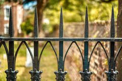 A closeup of the top of a wrought iron fence in Georgetown, SC. stock photos