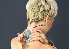 Closeup of topless woman with tattoo stock photography