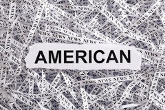 Closeup torn pieces and tapes of paper with the word AMERICAN. Black and White image. Concepts of money and business stock photo