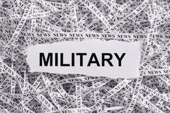 Closeup torn pieces and tapes of paper with the word MILITARY. Black and White image. Concepts of money and business royalty free stock photos