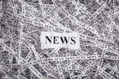 Closeup torn pieces and tapes of paper with the word NEWS. Royalty Free Stock Image