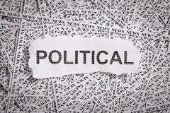 Closeup torn pieces and tapes of paper with the word POLITICAL. Stock Images